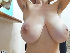 Drinking milk from huge natural breast